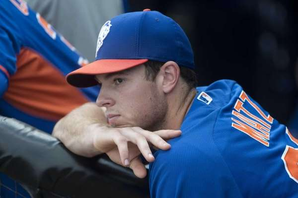 Mets pitcher Steven Matz looks on during spring
