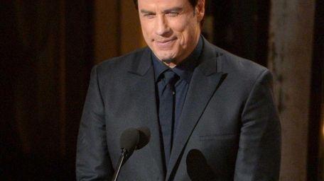 John Travolta speaks during the Oscars on Sunday,