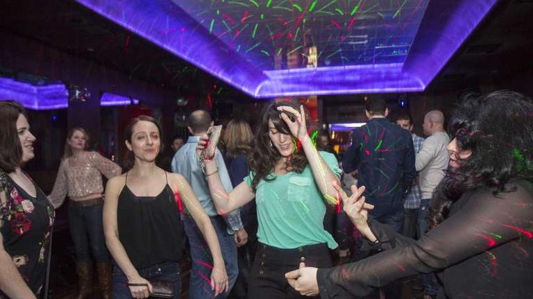 Patrons dance during a late-night party at Acacia
