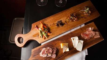 A cured-meat-and-cheese board with condiments serves as a