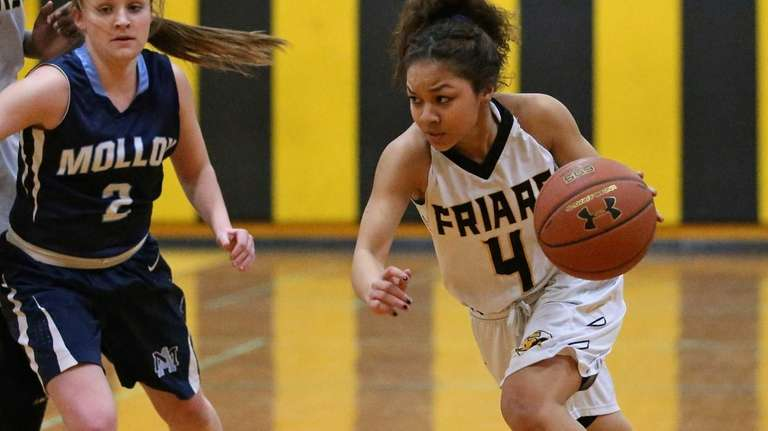 St. Anthony's Tyla Parham drives to the outside