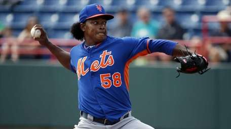 Mets starting pitcher Jenrry Mejia throws in the