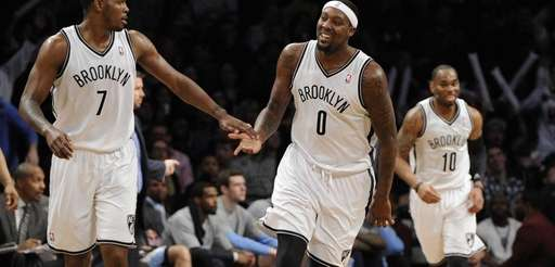 Nets forward/center Andray Blatche reacts with guard Joe