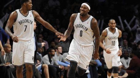 Nets forward/center Andray Blatche reacts with guard Joe