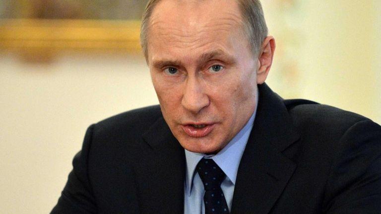 Russian President Vladimir Putin speaks at his meeting