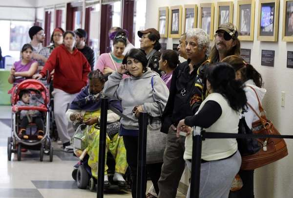 People line up at a food pantry at