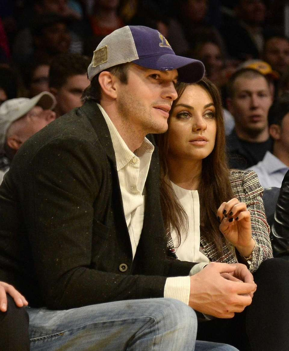 Ashton Kutcher and his fiancee, Mila Kunis, attend