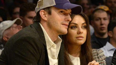 Ashton Kutcher and his fiancee Mila Kunis attend