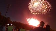 Revelers celebrate Independence Day by watching a Grucci