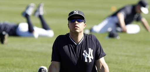 Mark Teixeira of the Yankees stretches out before