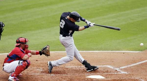 Derek Jeter, right, hits a single in front
