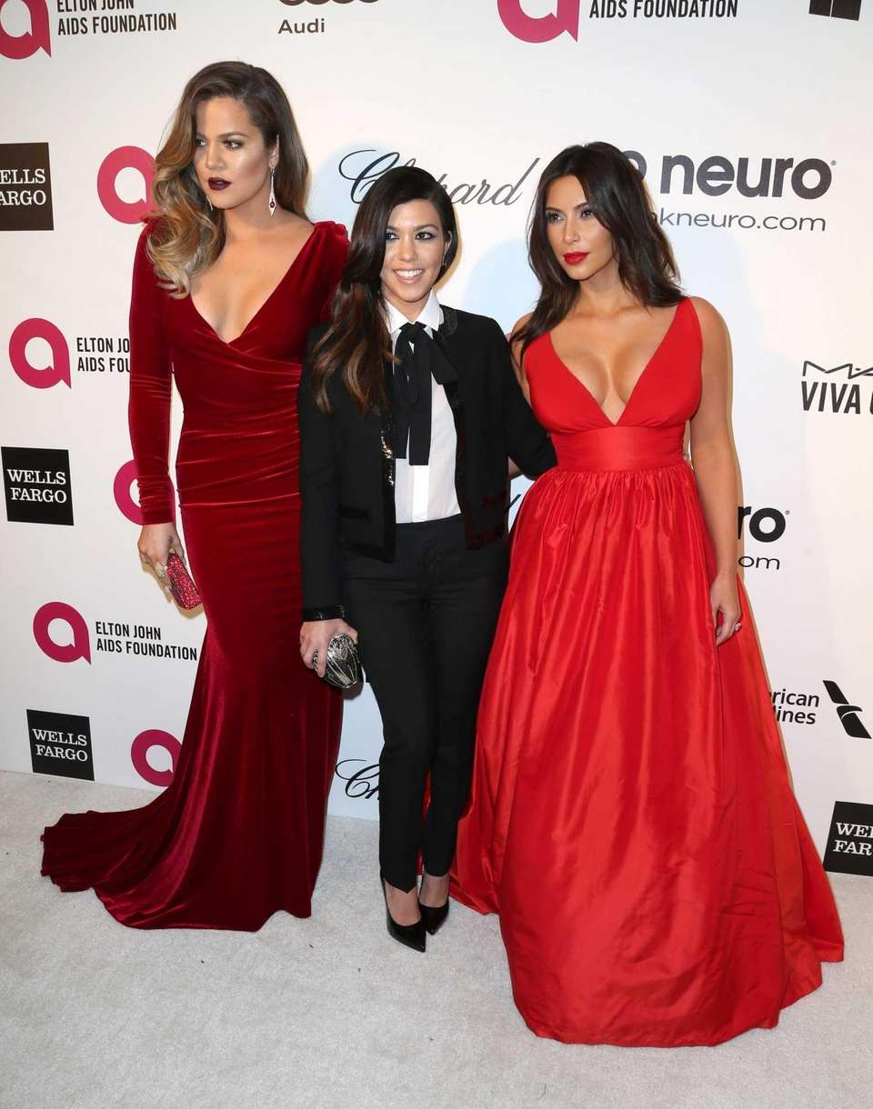 TV personalities Khloe Kardashian, Kourtney Kardashian and Kim