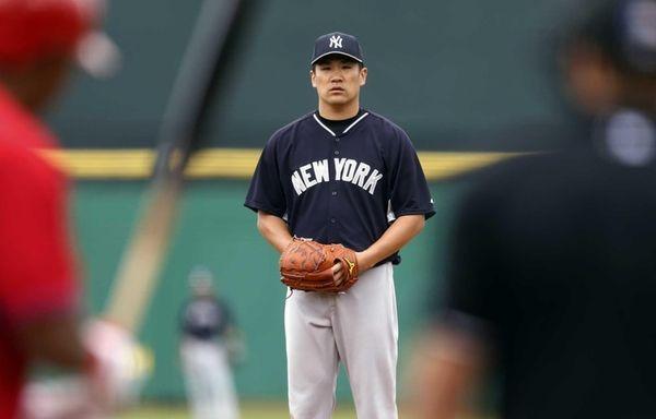 Masahiro Tanaka of the Yankees throws during a