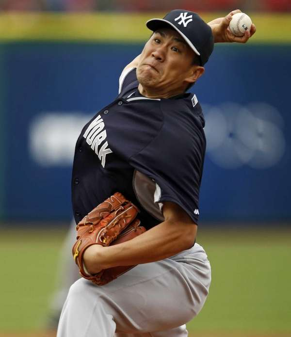 Masahiro Tanaka of the Yankees throws during a