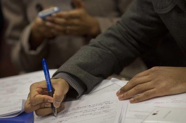 A job seeker fills out an application at