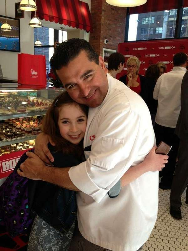 """Eleven-year-old Carrie Berk with """"Cake Boss"""" star Buddy"""