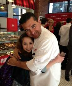 "Eleven-year-old Carrie Berk with ""Cake Boss"" star Buddy"
