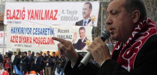 Turkish Prime Minister Recep Tayyip Erdogan addresses a
