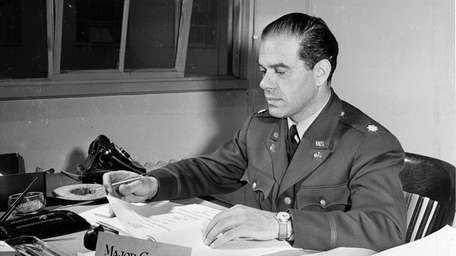 Major Frank Capra, movie director, at his desk