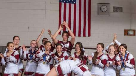 Mepham High School's co-ed varsity cheerleading team poses