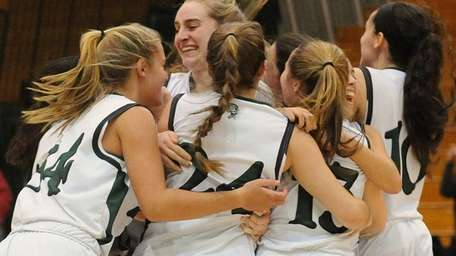Harborfields teammates celebrate after their 56-50 win over