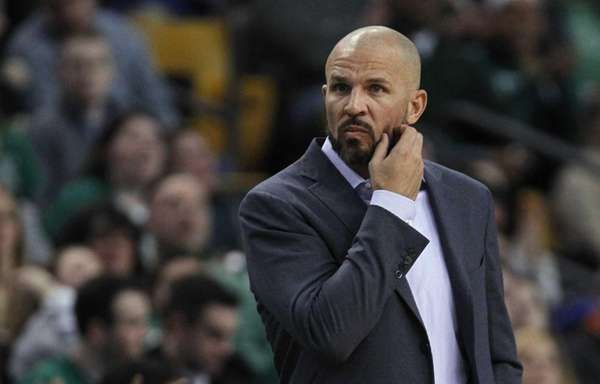 Nets coach Jason Kidd scratches his beard during