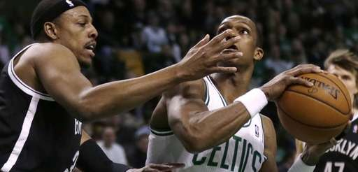 Nets forward Paul Pierce, left, defends Boston Celtics