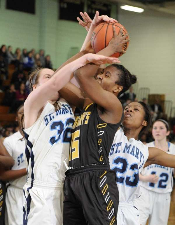St. Anthony's forward Kalifa Davy is fouled by