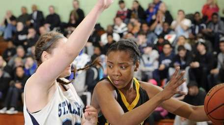 St. Anthony's forward Kalifa Davy is defended by