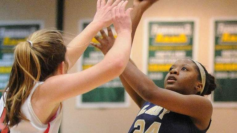 Baldwin's Mariah Butler, right, tries to get a