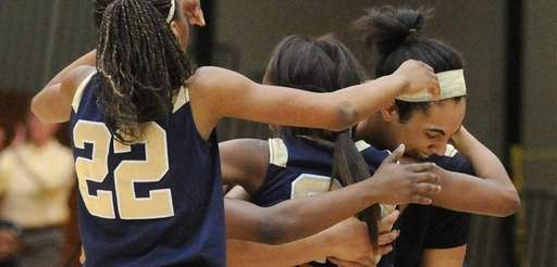 Baldwin teammates, from left, Tiara Place, Tyra Harrison