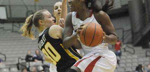 Stony Brook's Jessica Ogunnorin drives past UMBC's Sara