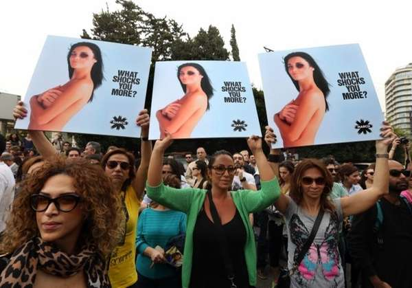 Lebanese women hold posters to mark International Woman's