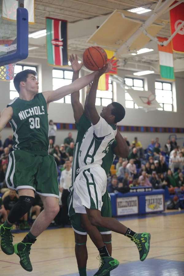 Holy Trinity's Brandon Thomson scores two points while