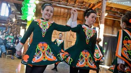 Irish step dancer Clare Owens, right, holds hands