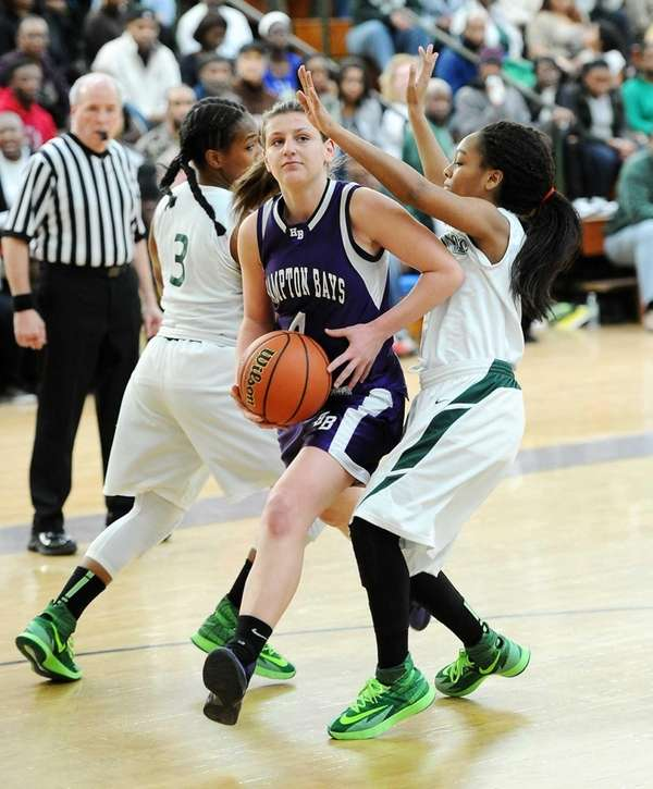 Alexis Fotopoulos of Hampton Bays is guarded by