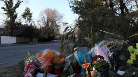 A memorial sits at the scene off Roslyn