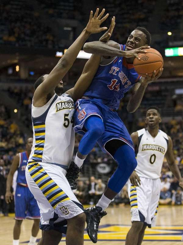 Marquette's Davante Gardner, left, defends as St. John's