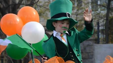 First grader Nicholas Spano, 7, plays a leprechaun