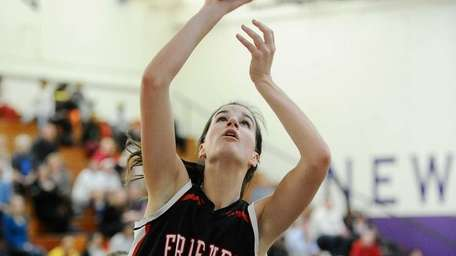 Rose Mangiarotti of Friends Academy shoots at basket