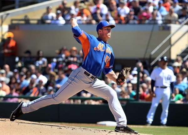 Mets pitcher Noah Syndergaard throws a pitch during