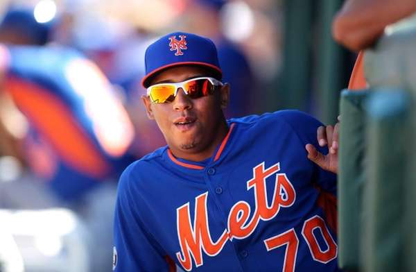 Mets infielder Wilfredo Tovar looks out from the