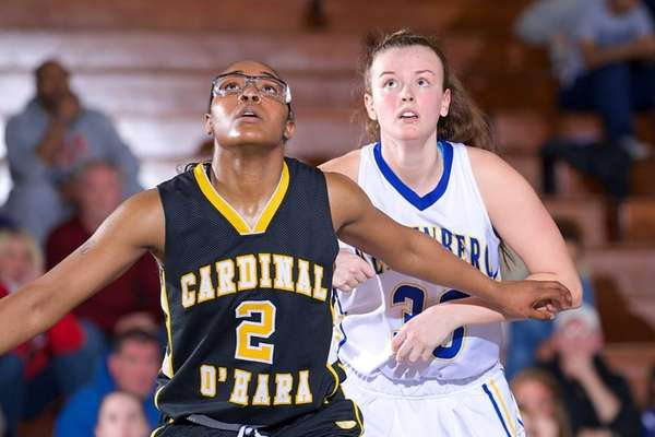 Kellenberg's Cristen Whigham is boxed out by Cardinal
