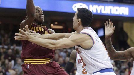 Cavaliers' Jarrett Jack passes over Knicks' Pablo Prigioni