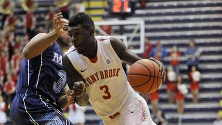 Stony Brook's Ahmad Walker moves the ball against