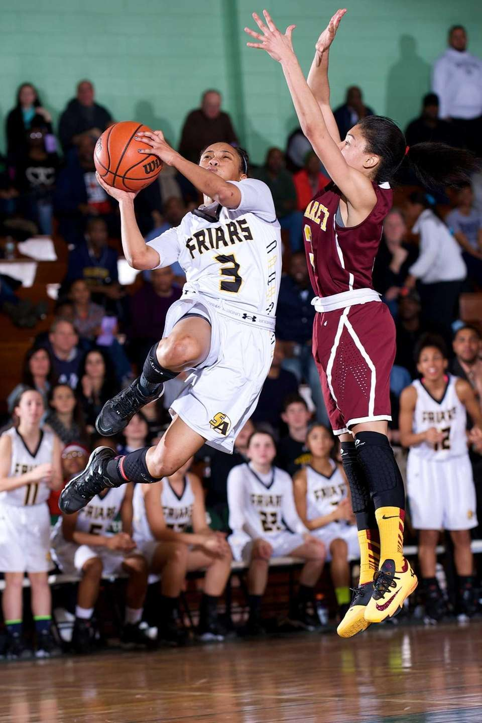 St. Anthony's guard Charise Wilson puts up a
