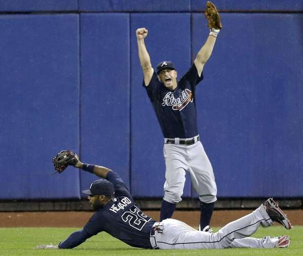 Atlanta Braves left fielder Reed Johnson right, leaps