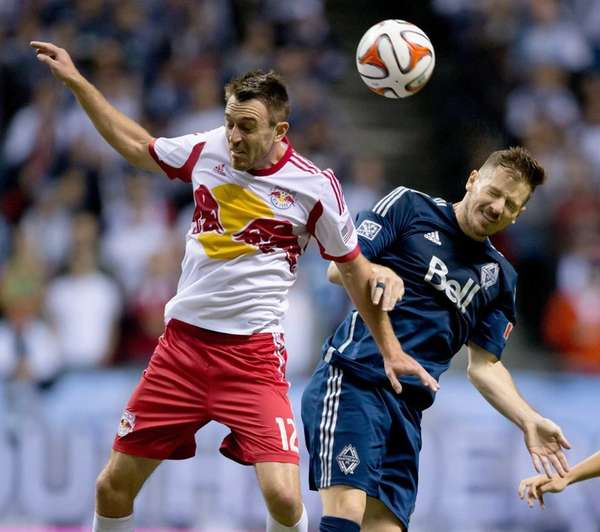 Red Bulls' Eric Alexander, left, and Vancouver Whitecaps'