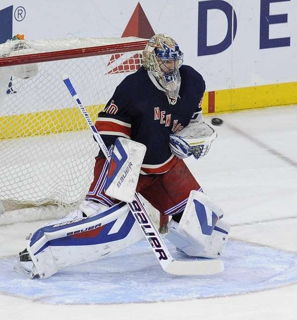 Henrik Lundqvist makes a save against the Detroit