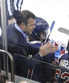 Alain Vigneault reacts after the Rangers scored against